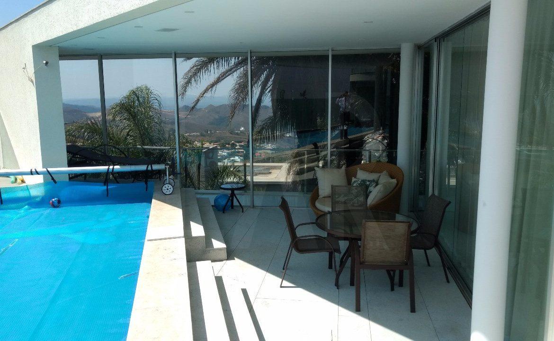 Foto Casa em Condomínio de 4 quartos à venda no Riviera em Nova Lima - Imagem