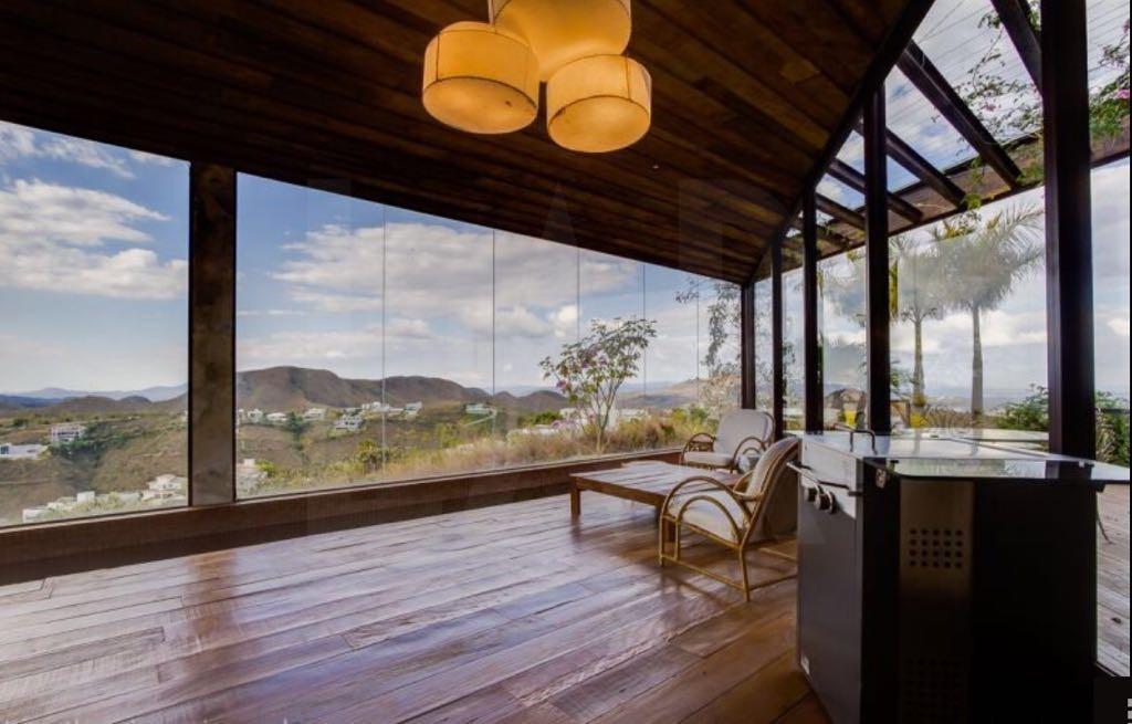 Foto Casa em Condomínio de 4 quartos para alugar no Vale dos Cristais em Nova Lima - Imagem 02